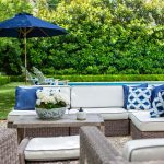 Blue and White Outdoor Living Area with Umbrella