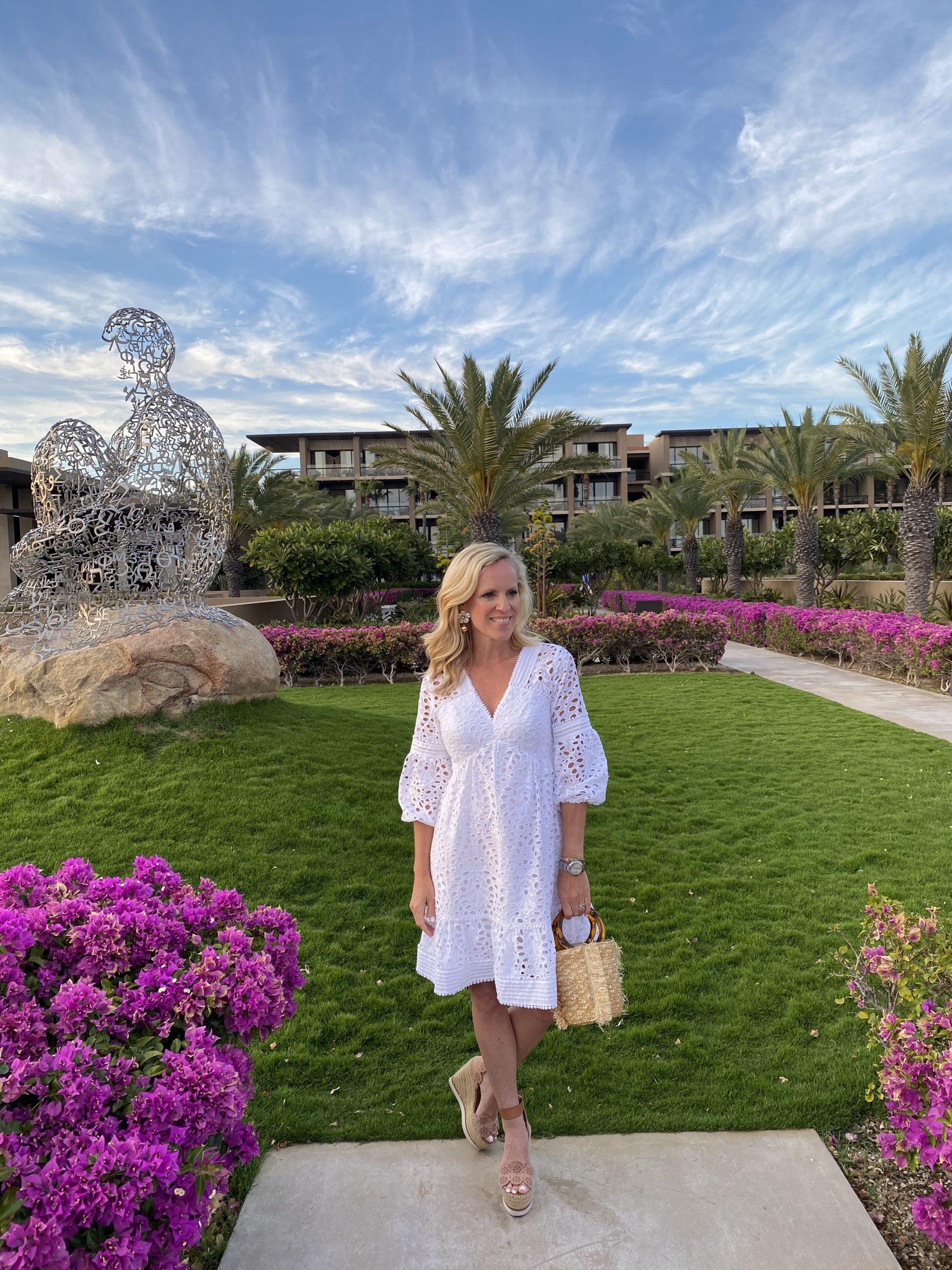 woman in white dress standing in garden